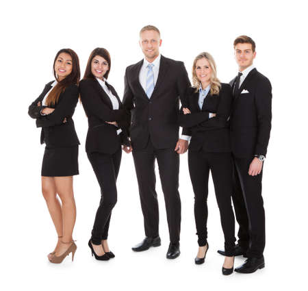 Full length portrait of welldressed businesspeople standing against white background photo