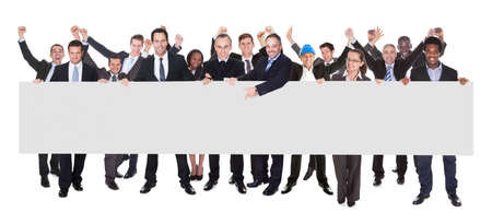 panoramic business: Multiethnic businesspeople holding blank billboard against white background