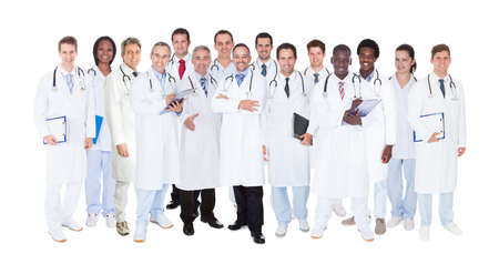 old people group: Large group confident doctors standing against white background Stock Photo