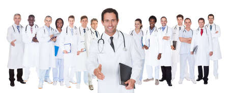Large group confident doctors standing against white background photo