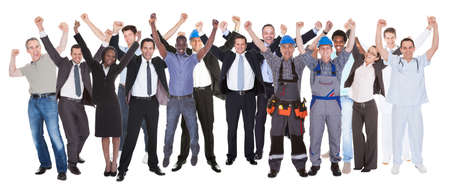 Full length of excited people with different occupations celebrating success over white background photo