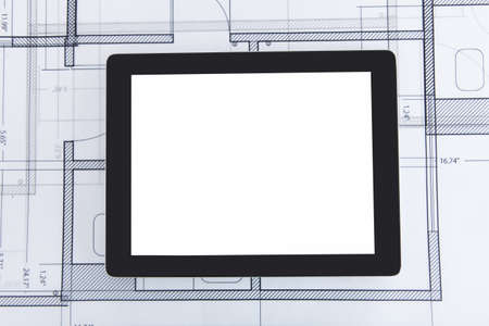 Closeup photo of digital tablet on blueprint photo