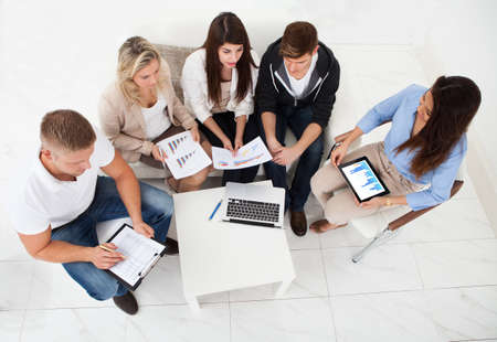 High angle view of businesspeople working in office photo