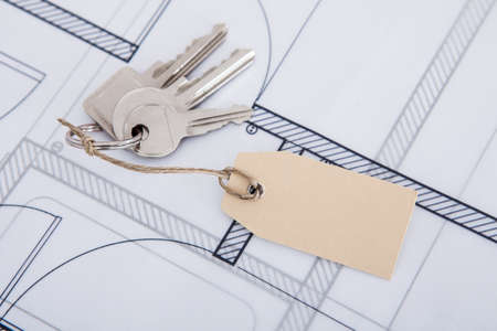 Closeup of keys with tag on blueprint photo