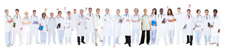 Panoramic shot of confident doctors standing against white background Stock Photo - 28957721