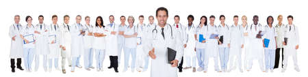 Panoramic shot of confident doctors standing against white background Stock Photo - 28957723