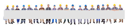 Portrait of diverse manual workers holding blank billboard against white background photo