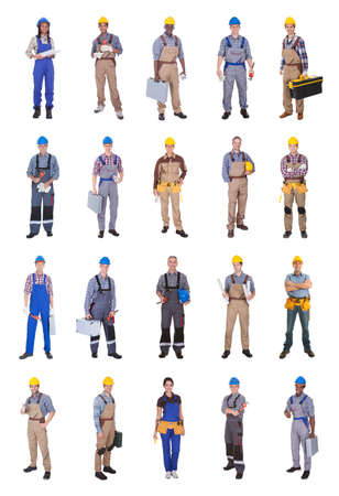 Full length of confident multiethnic engineers standing against white background Stock Photo - 28957835