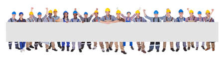Portrait of successful manual workers with blank billboard against white background Stock Photo - 28957847