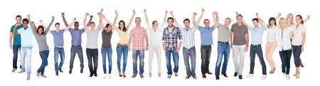 Full length portrait of diverse people in casuals celebrating success against white background photo