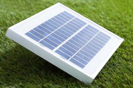 environmental conversation: Closeup photo of solar panel on grass Stock Photo