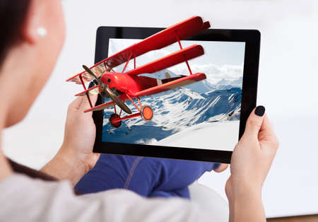 Cropped image of woman watching 3D movie on digital tablet at home photo