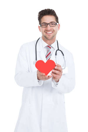 heart doctor: Portrait of confident young male doctor holding heart over white background Stock Photo
