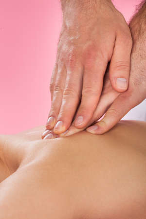 color therapist: Closeup of male therapist massaging female customers back at beauty spa