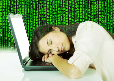 Digital composite image of young woman sleeping on laptop at desk with Stock Photo - 29323490