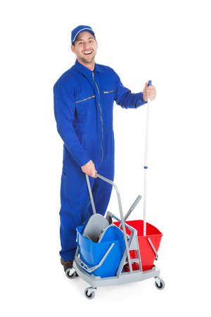 up service: Full length portrait of confident cleaner showing thumbs up over white background Stock Photo