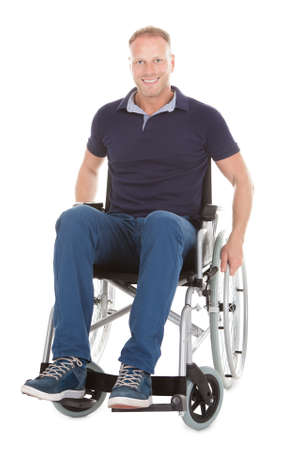 Full length portrait of disabled man on wheelchair over white background