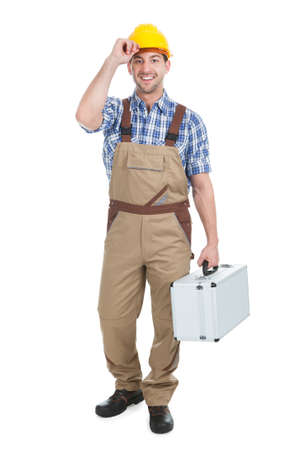 studio happy overall: Full length portrait of young manual worker with toolbox over white  Stock Photo