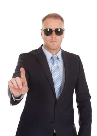 bodyguard: Portrait of confident bodyguard making stop gesture over white