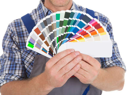 fanned: Midsection of handyman showing fanned color swatches over white