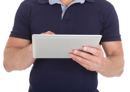 midsection: Midsection of man using digital tablet over white background