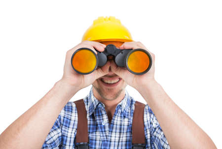 Full length of young male repairman looking through binoculars over white  photo