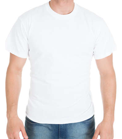 blank t shirt: Midsection of young man wearing blank t shirt over white