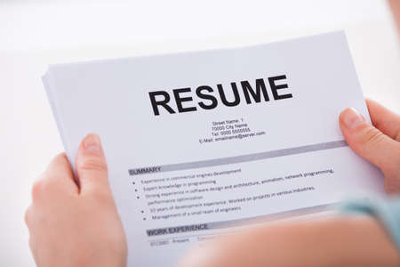 recruit: Cropped image of young woman holding resume over white
