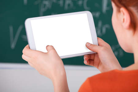 cropped image: Cropped image of young woman using digital tablet in classroom