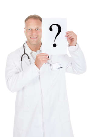 Portrait of smiling mid adult doctor holding paper with question mark over white  photo