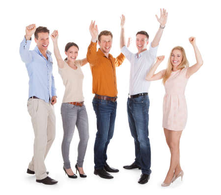 Full length of excited young friends jumping isolated over white  photo