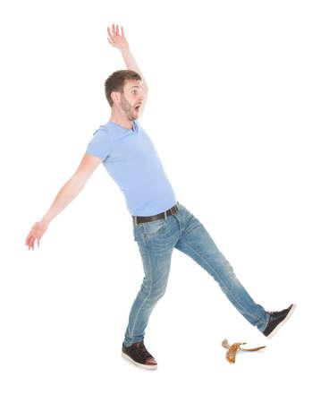Full length of man slipping over white