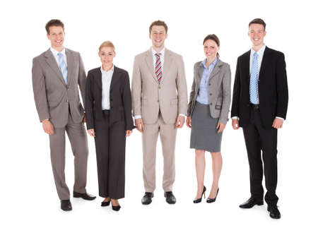 Full length portrait of confident young business people standing isolated over white background photo