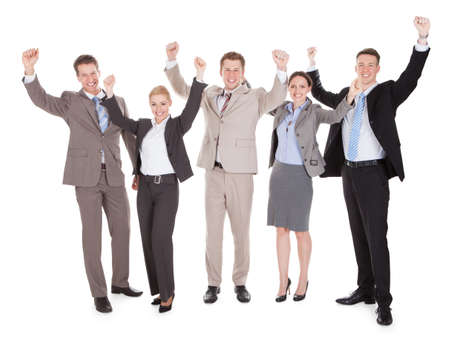 Full length of excited young business people cheering over white background photo