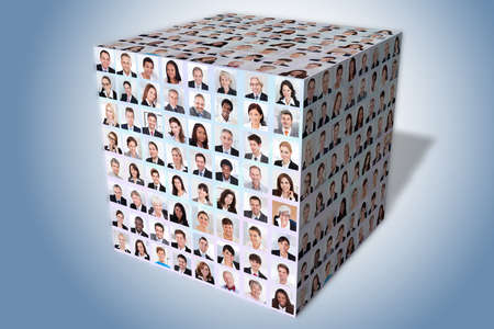 Collage of diverse business people in cube over blue background photo