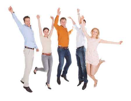 man jump: Full length of excited young friends jumping isolated over white background