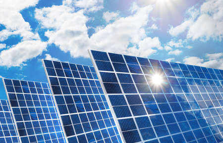 electrical energy: Solar panels in row against cloudy sky