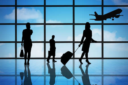 Silhouette business people at airport terminal hall Stock Photo