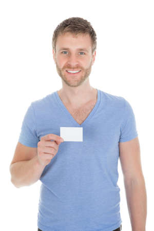 waistup: Portrait of confident man holding visiting card over white background