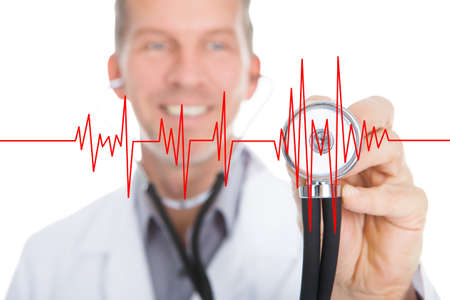 listening to heartbeat: Happy doctor listening heartbeat through stethoscope on transparent screen Stock Photo