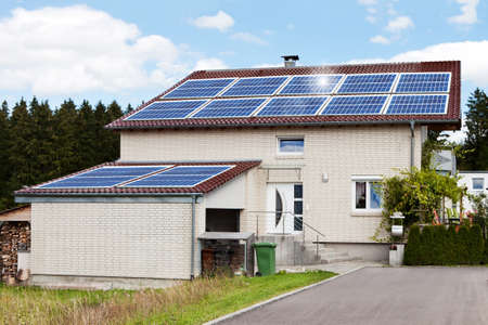 GREEN BUILDINGS: Exterior of dream house with solar panels on roof