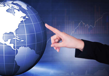 Cropped image of businesswoman touching globe representing globalization.  photo