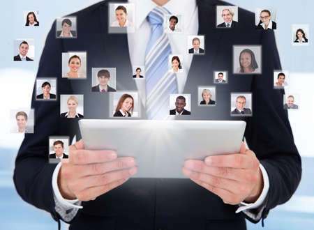Collage of business people with businessman using digital tablet representing global communication photo