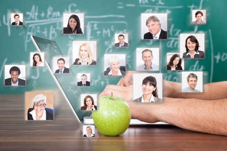 technology collage: Collage of business people with hand using laptop by green apple representing global communication Stock Photo