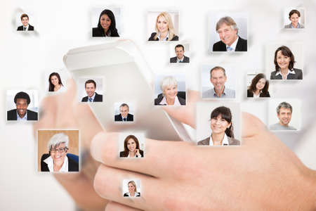 Collage of business people with hands using cell phone representing global communication photo