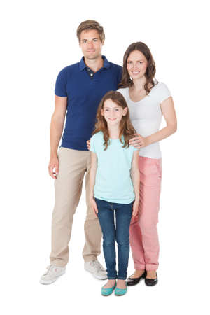 casuals: Full length portrait of family in casuals standing over white background Stock Photo