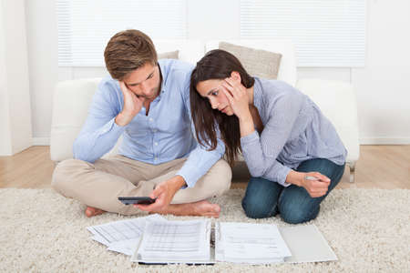 retirement homes: Unhappy young couple in financial trouble at home