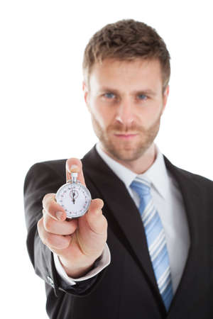 waistup: Portrait of confident businessman showing stopwatch over white background Stock Photo