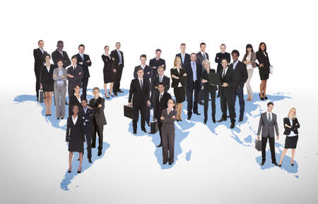 Multiethnic business people standing on world map representing global business. Source of reference map: http://visibleearth.nasa.gov/view.php?id=74518. Illustration was created on the 15th of May, 2014 using Photoshop CS5. 1 layer of data was used for th Stock Illustration - 30580800