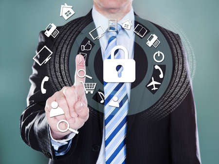 job security: Midsection of businessman pressing virtual icons over colored background Stock Photo